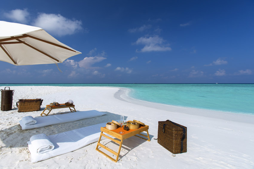 private sandbank picnic on white sand beach with turquoise water, the Maldives
