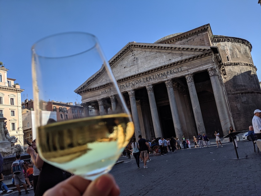 Pantheon in Rome viewed through a glass of white wine