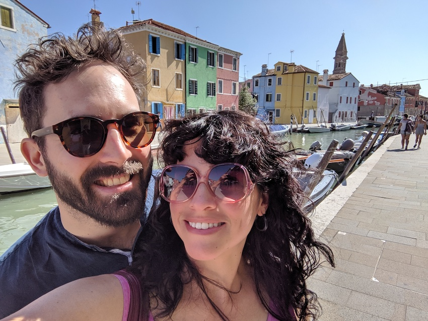 Couple taking selfie on honeymoon in Italy