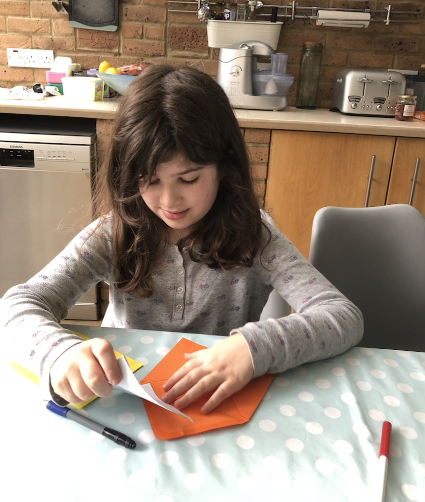 Girl putting letter in to envelope