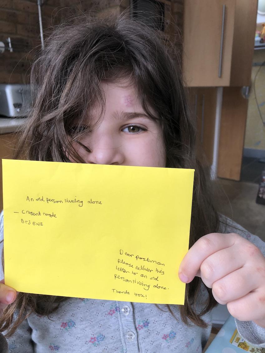 Girl holding up hand written letter