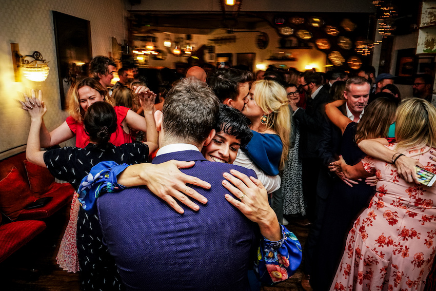 Couple dancing and embracing at their wedding party