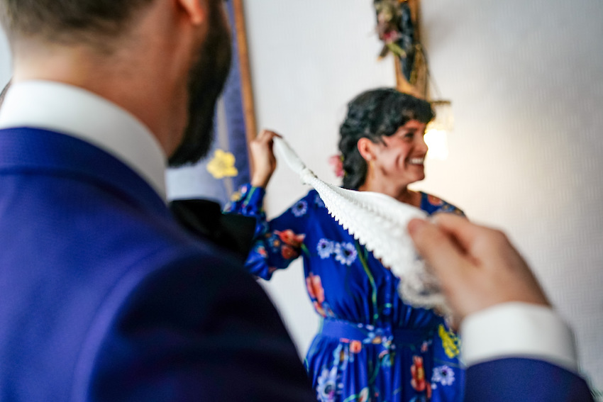 Couple on wedding day taking part in hand tying ceremony