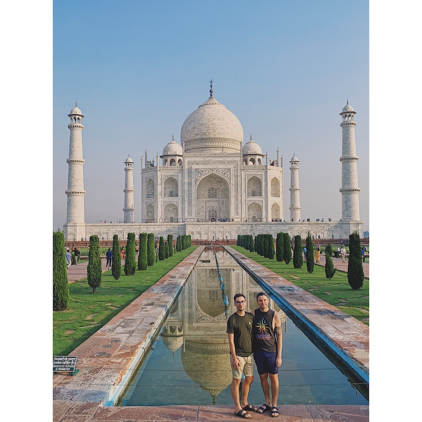 Patchwork Couple on honeymoon in India in front of Taj Mahal