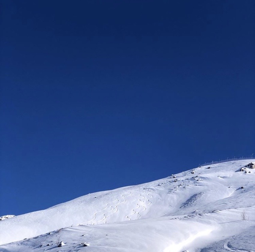 view of ski slopes and blue sky - ski honeymoon