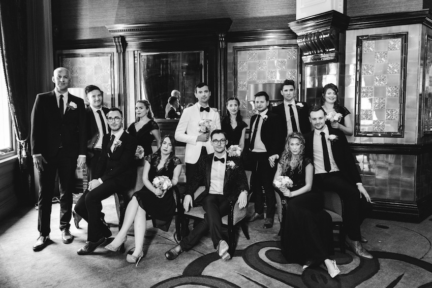 Black and white image of groom and groom and wedding party - formal shot