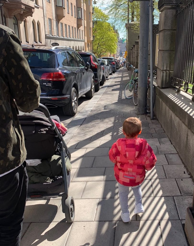 Patchwork Kids: Toddler walking on pavement next to pram