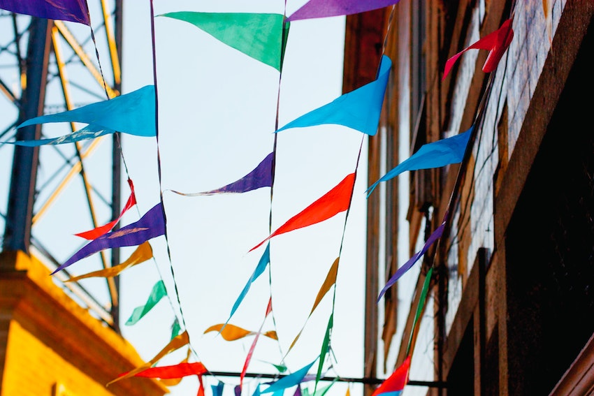 multicoloured bunting against sky