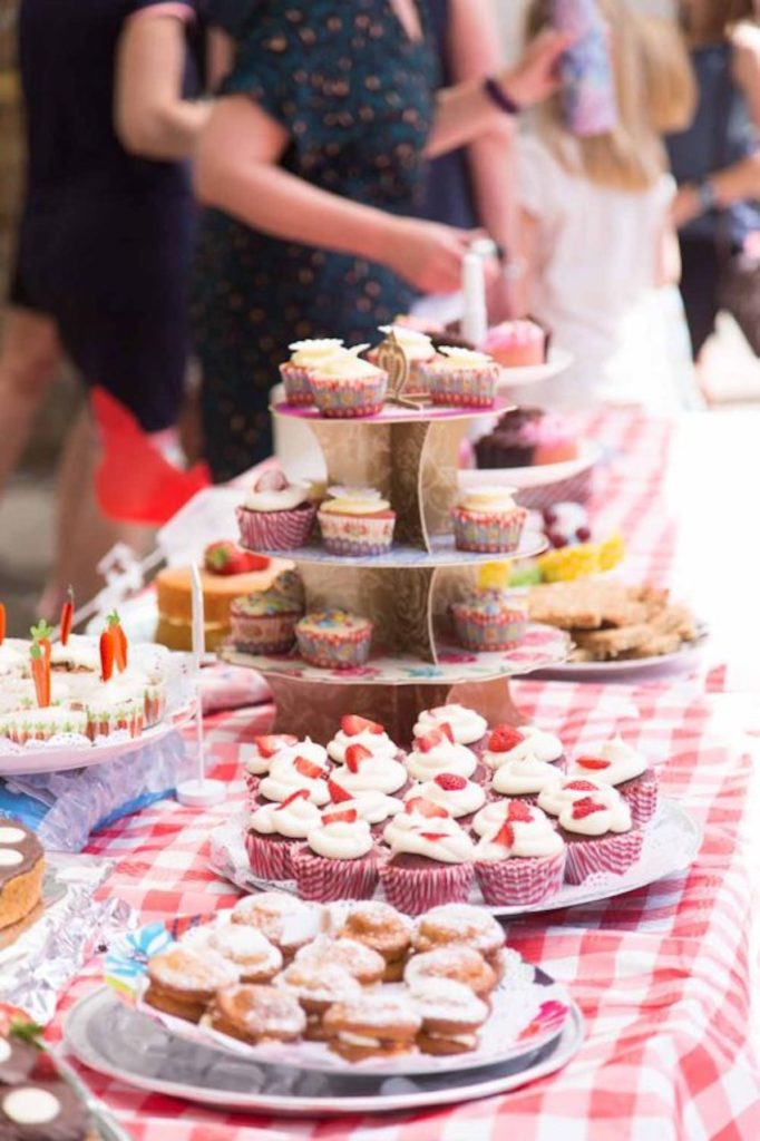 Cakes for sale on stall at school summer fair