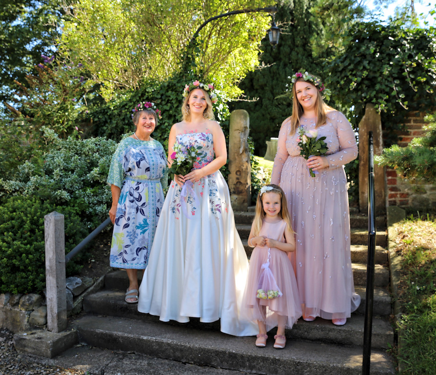 Bride, mother, bridesmaid and flower girl at their small wedding ceremony during Covid-19 pandemic