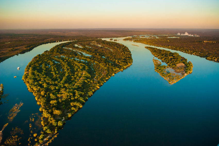 Aerial view of the Zambezi river with riverboats honeymoon destination
