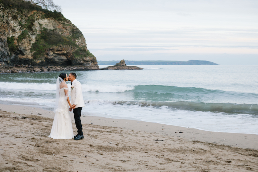 Bride and Groom kissing on Porthpean beach, Cornwall
