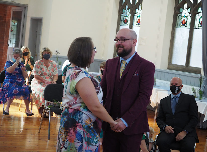Bride and Groom making vows during Covid socially distanced wedding ceremony