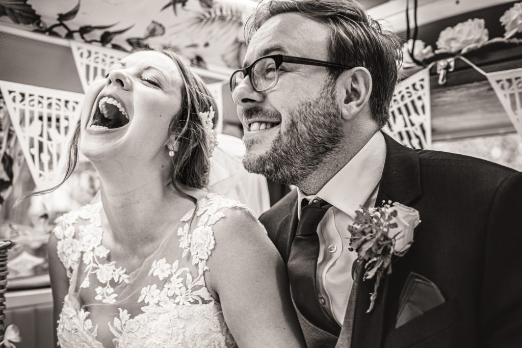 Close up of Bride and Groom laughing on wedding day