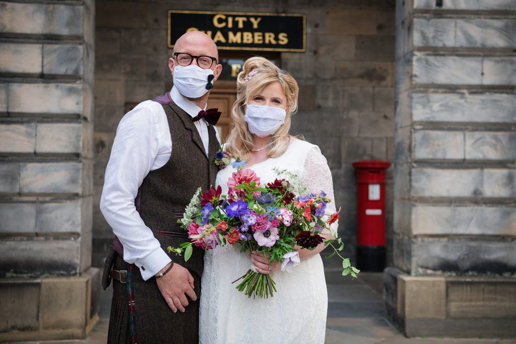 Bride and groom during Covid-19 secure wedding with masks on