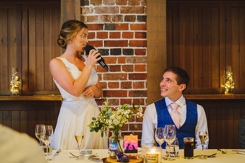 Bride making speech at wedding reception