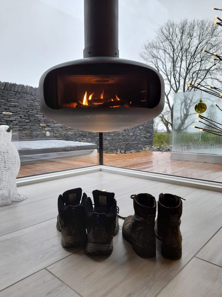 walking boots by log burner - The Gilpin Hotel