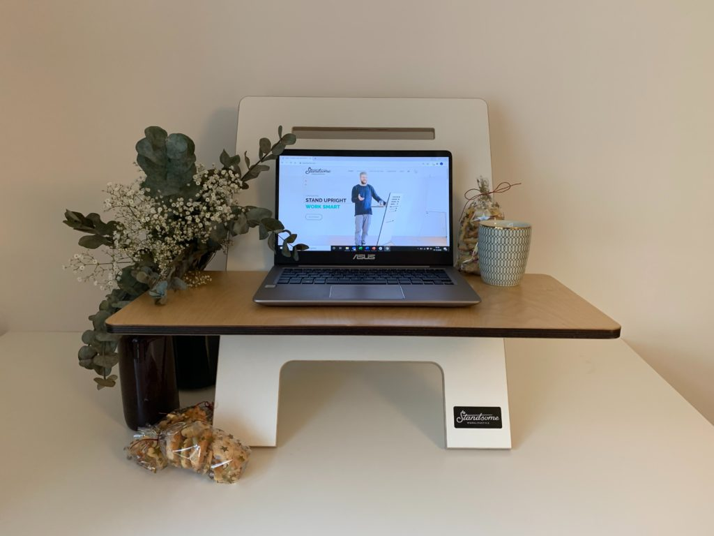 a laptop sits atop a laptop stand