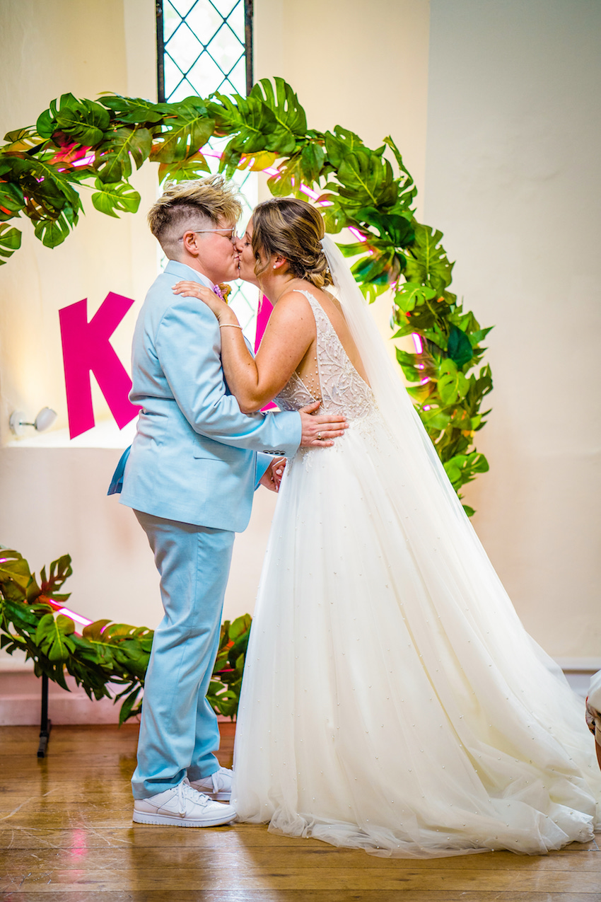 Kerry & Leah kiss on their colourful wedding day June 2021