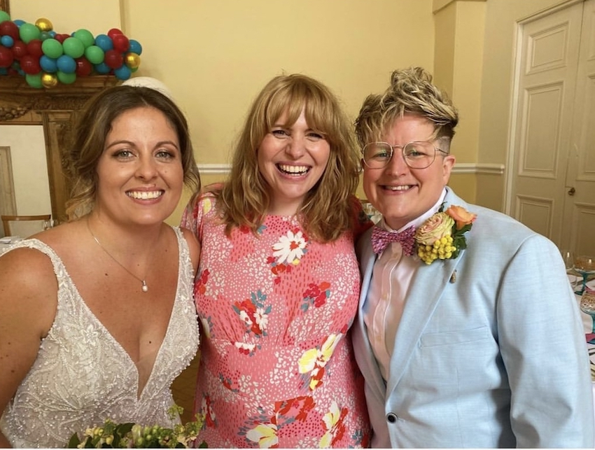 Kerry and Leah with celebrant Sarah Powell at their colourful Farnham castle wedding